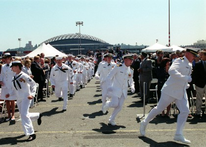 US Navy 020622-N-8252B-010 Sailors stationed aboard USS Shoup run to ^ldquo,man the rails^rdquo, during the commissioning ceremony