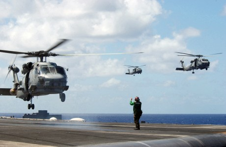 US Navy 030216-N-7265L-019 The Landing Signal Enlisted (LSE) signals the pilot of an SH-60B Seahawk assigned to the