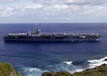 US Navy 030225-N-7293M-001 The aircraft carrier USS Carl Vinson (CVN 70) enters Apra Harbor during its first ever port call to Guam