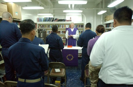 US Navy 030407-N-5555F-038 Cdr. Jerome Dillon, U.S. Navy chaplain from South Sioux City, Neb., conducts Roman Catholic Mass aboard the fast combat support ship USS Sacramento (AOE 1