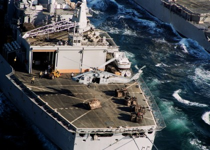 US Navy 031111-N-6259P-012 An MH-60S sets a crate on the deck of USS Detroit (AOE 4)