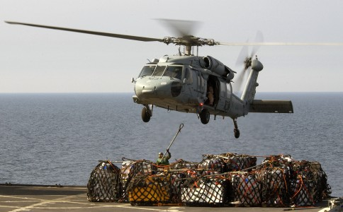 US Navy 040326-N-5319A-003 A crewmember assigned to USNS Sirius (T-AFS 8) attaches a cargo sling to a MH-60S Knighthawk