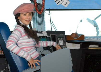 US Navy 040416-N-0119G-001 Country music entertainer Sherrie Austin sits in the Captain's chair on the bridge aboard the nuclear powered aircraft carrier USS Enterprise (CVN 65)