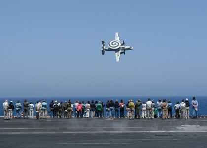 US Navy 040611-N-9742R-100 Members of the 67th Joint Civilian Orientation Conference (JCOC) observe the fly-by of an E-2C Hawkeye