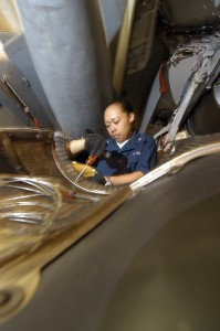 US Navy 040627-N-7748K-019 Aviation Machinist's Mate 3rd Class Irene Sotelo, from Waianae, Hawaii, removes rivets from an EA-6B Prowler engine bay wall