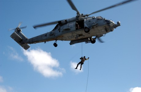 US Navy 050214-N-7265L-026 Sailors assigned to Explosive Ordnance Disposal Mobile Unit Eleven (EODMU-11), Detachment Nine, fast rope from an HH-60H Seahawk helicopter