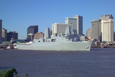 US Navy 061023-N-0857S-003 The Pre-Commissioning Unit New Orleans (LPD 18) transits past the city of New Orleans on the Mississippi River