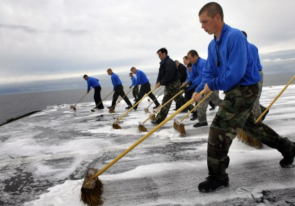 US Navy 070627-N-4166B-208 Sailors sweep down the flight deck of Nimitz-class aircraft carrier USS Abraham Lincoln (CVN 72) during an aqueous film forming foam (AFFF) countermeasure wash down