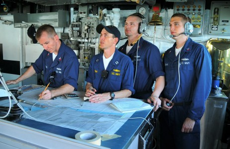 US Navy 090626-N-4774B-036 Navigation officer Lt. Michael Hurban, center, digitally charts a course on the bridge of the guided-missile cruiser USS Lake Champlain (CG 57)
