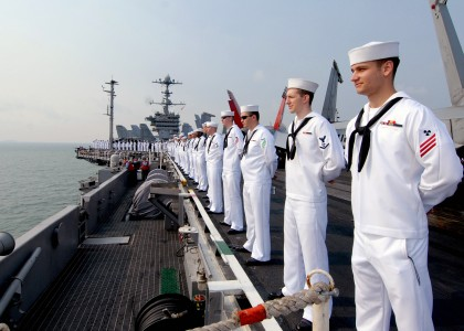 US Navy 090802-N-6720T-045 Sailors man the rails aboard the aircraft carrier USS George Washington (CVN 73) while underway off the coast of Singapore
