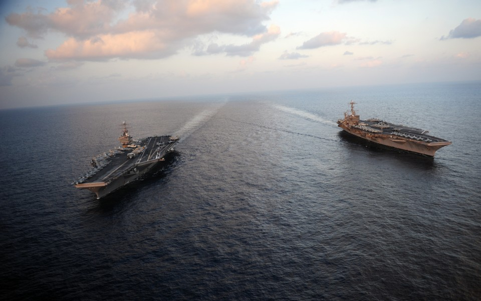 120119-N-YL945-045 - USS Abraham Lincoln (CVN 72) and USS John C. Stennis (CVN 74) join for a turnover of responsibility in the Arabian Sea