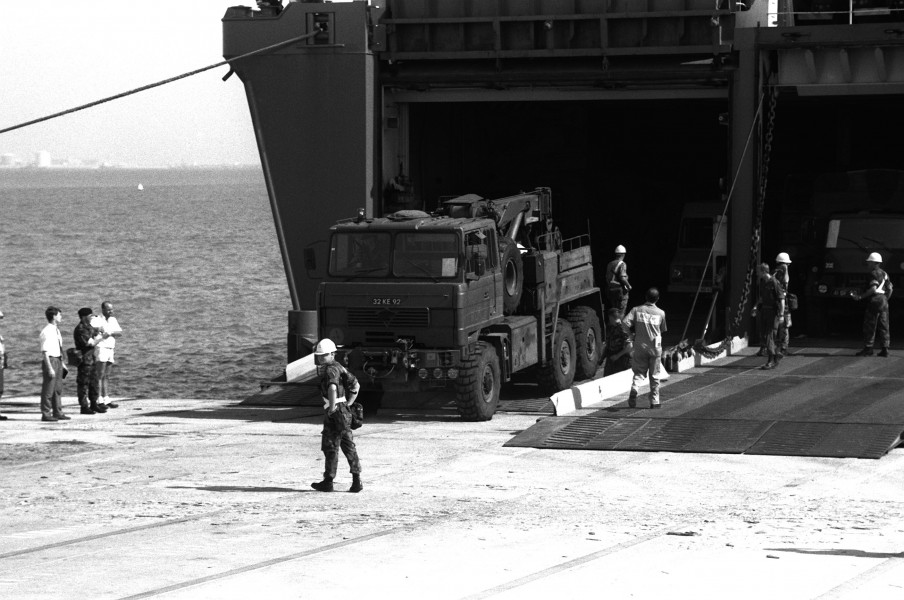 A British Foden 6x6 recovery vehicle leaves the Danish cargo ship Dana Cimbria during Operation Desert Shield