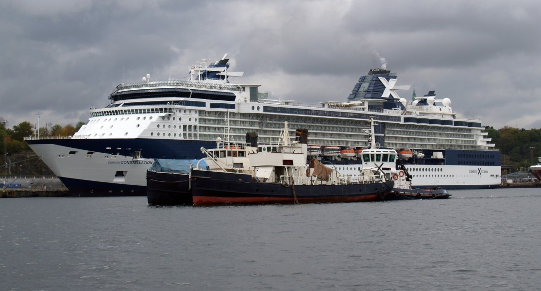 Celebrity Constellation and Tugboats
