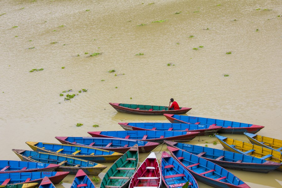 Colorful Boats waiting in the bank of Fewa Lake, Pokhara during rainy season. (By Saroj Pandey)