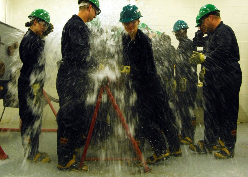 Defense.gov News Photo 110715-N-YC845-428 - First class petty officers from Naval Support Activity Norfolk commands train at the Farrier Firefighting School damage control wet trainer USS