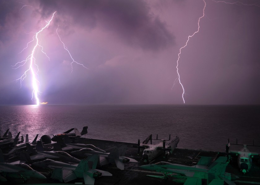 Lightning flashes as the aircraft carrier USS Abraham Lincoln (CVN 72) transits the Strait of Malacca