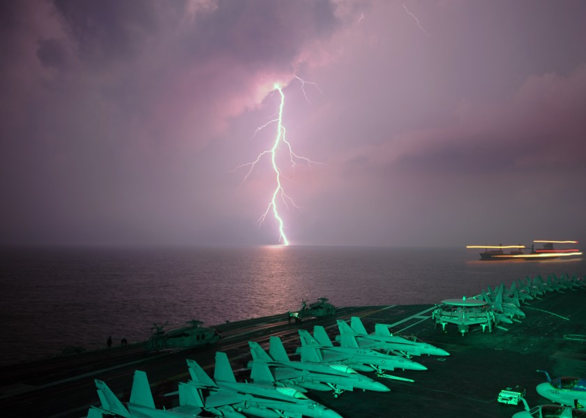 Lightning flashes in view of the aircraft carrier USS Abraham Lincoln (CVN-72)