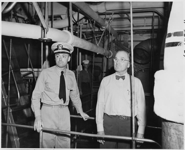 Lt. Commander N. V. King, Engineering Officer, conducts President Harry S. Truman through the engine room on a tour... - NARA - 198733