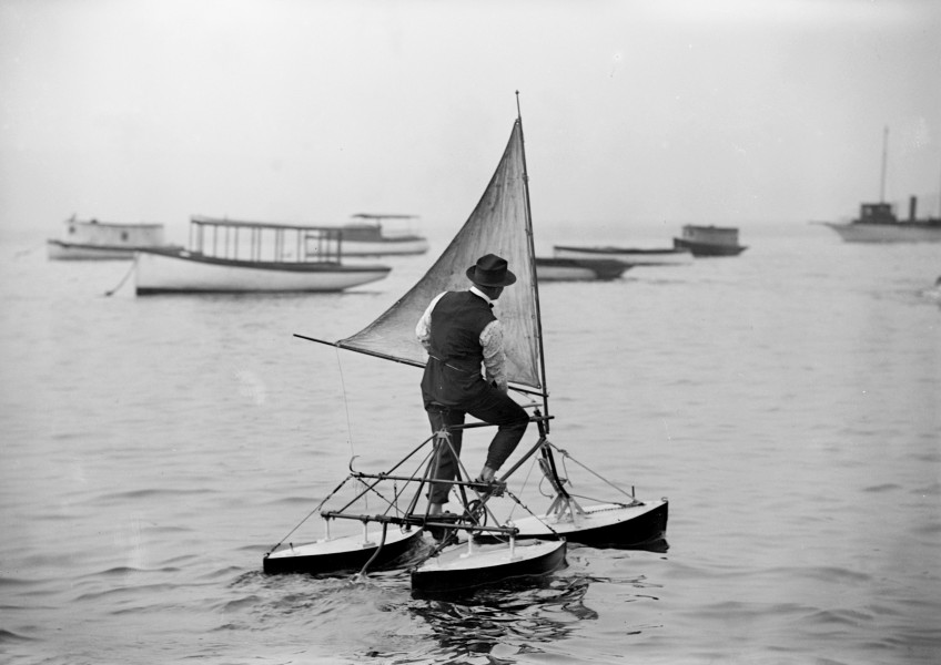 Man operating water tricycle, ca. 1900