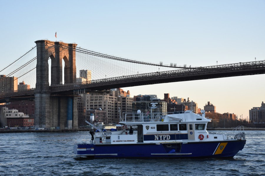 NYPD police boat, Brooklyn Bridge and Downtown Brooklyn at sunset