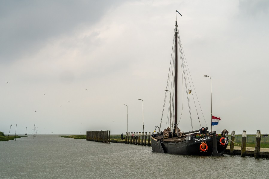 Old transport ship in the smallest sea going harbour of the Netherlands