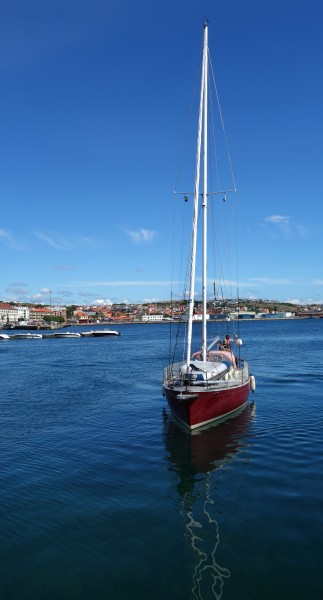 Red sailing boat south harbor Lysekil