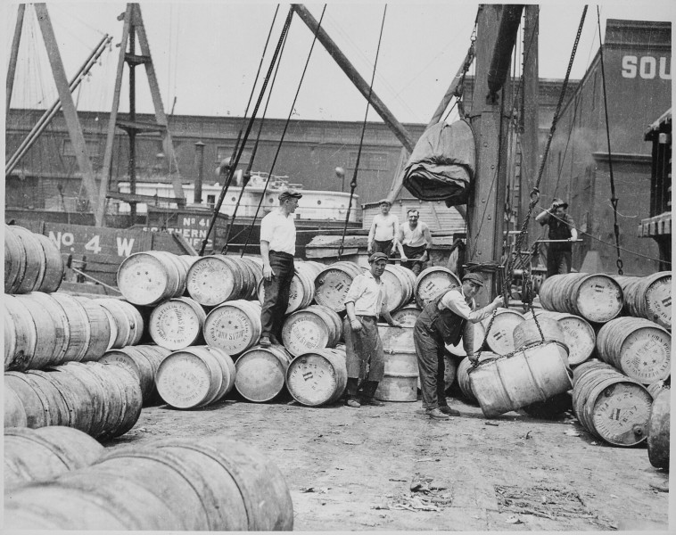 Stevedores on a New York Dock Loading Barrels of Corn Dyrup onto a Barge on the Hudson River, ca. 1912 - NARA - 518287