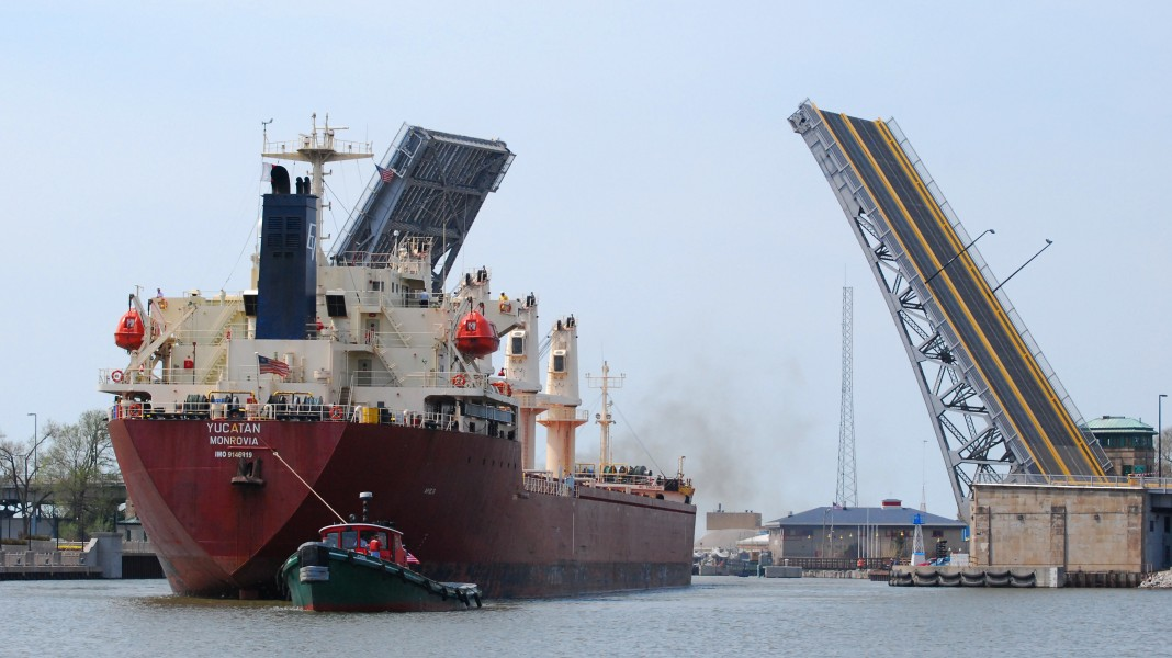 The Yucatan enters harbour in Lorain, Ohio with the assistance of the tug Iowa