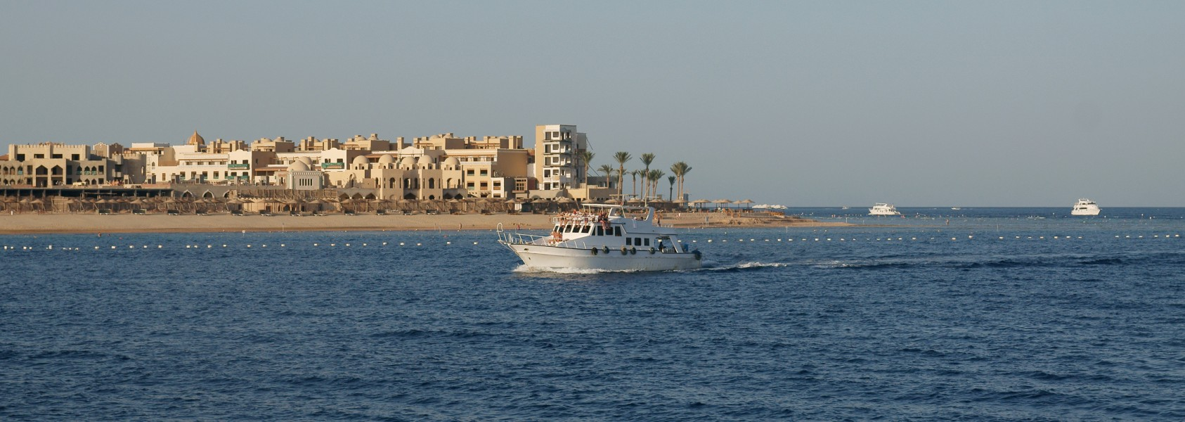 Tip of Makadi Bay with cruising boat