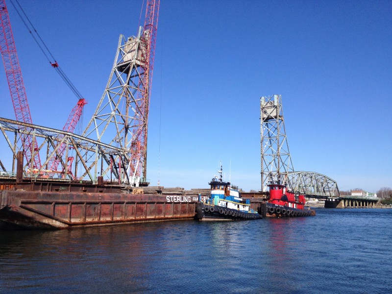 Tugboats and a barge working on the deconstruction of the Memorial Bridge, Portsmouth, NH
