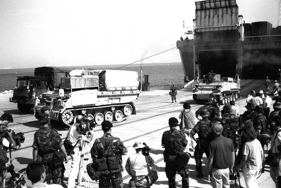Two British FV432 armored vehicles leave the Danish cargo ship Dana Cimbria during Operation Desert Shield