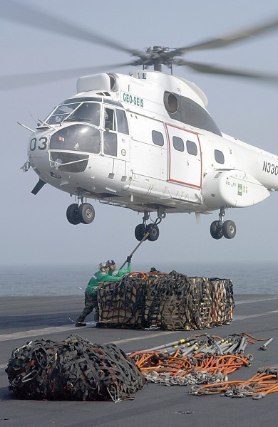 US Navy 020729-N-2329T-002 Sailors attach a Cargo Net to a Puma Helicopter