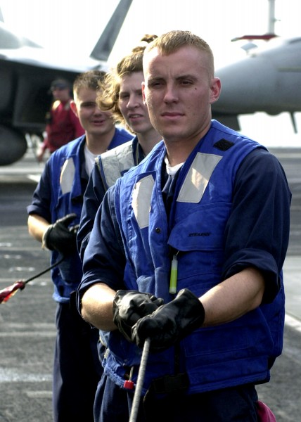 US Navy 020924-N-9593M-050 Three Seaman assigned to Deck Division serve as line handlers during a underway replenishment at sea (UNREP) with the Fast Combatant Support ship USS Camden (AOE-2)