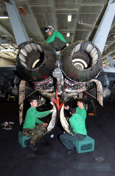 US Navy 020928-N-6817C-001 Super Hornet receives maintenance in hangar bay aboard CVN 72