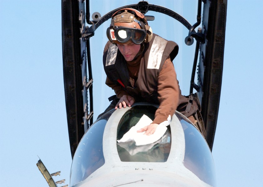 US Navy 021112-N-9593M-045 Aviation Electrician's Mate cleans the front canopy on an F-14D