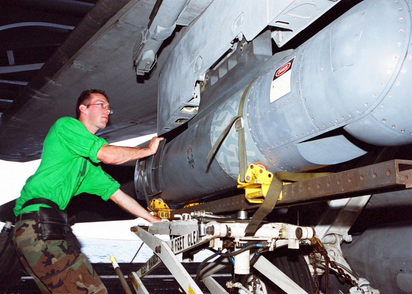 US Navy 030122-N-9403F-002 Electronics Technician 2nd Class Michael Weston of Sedley, Calif., loads a Forward Looking Infrared (FLIR) pod under the wing of an F-14D Tomcat fighter aircraft