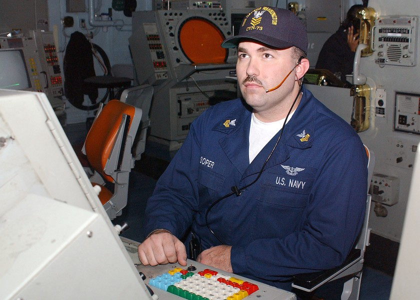 US Navy 030127-N-6653S-001 Air Traffic Controller 1st Class Brian Soper keeps track of incoming and outgoing aircraft on his radar console