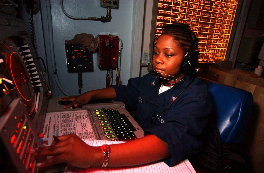 US Navy 030214-N-1350S-011 Operations Specialist 3rd Class Natasha Whiteside tracks contacts in the Tactical Operations Plot room