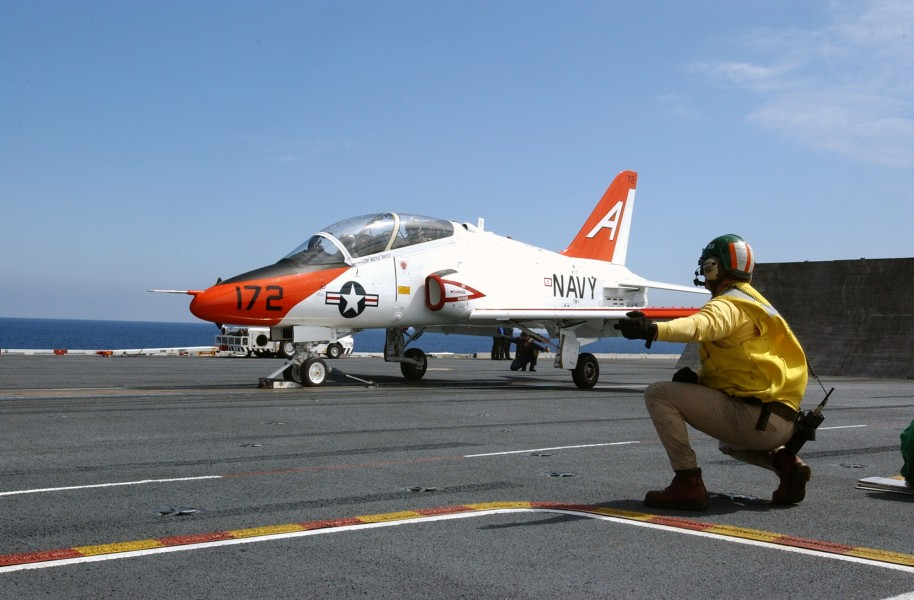 US Navy 030314-N-4768W-051 A T-45C Goshawk receives the launch signal from a shooter on the flight deck of USS John C. Stennis (CVN 74)