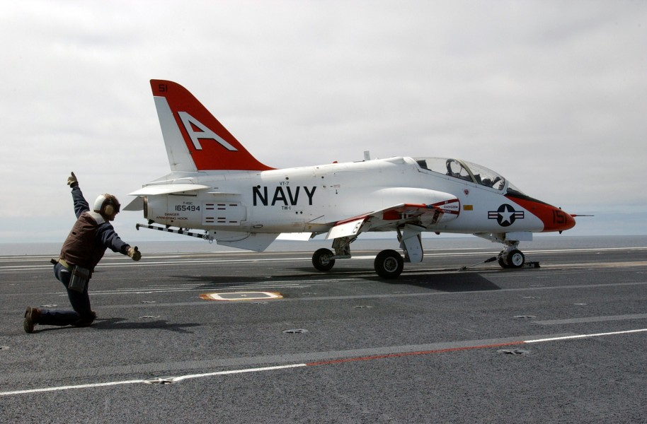 US Navy 030314-N-4768W-055 A T-45C Goshawk recieves the launch signal from a shooter on the flight deck aboard USS John C. Stennis (CVN 74)