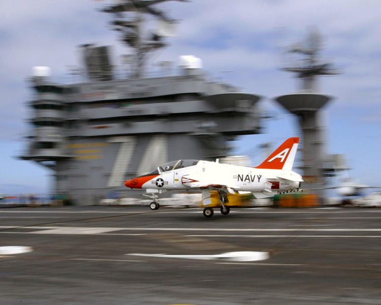 US Navy 030314-N-9769P-130 A T-45C Goshawk makes a touch and go pass on the flight deck aboard USS John C. Stennis (CVN 74)