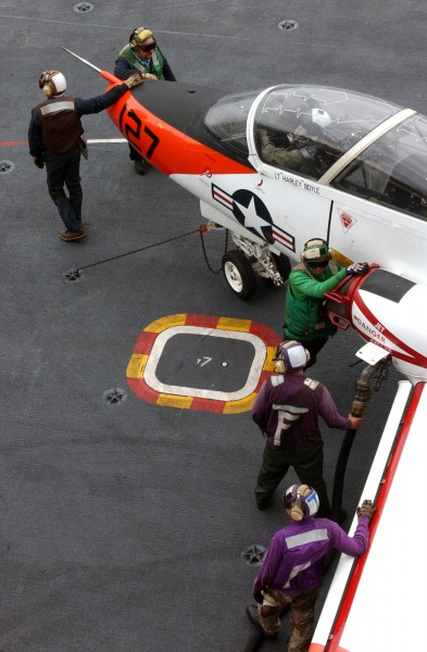 US Navy 030315-N-9060G-054 Flight deck Sailors refuel a T-45C Goshawk aboard USS John C. Stennis (CVN 74)