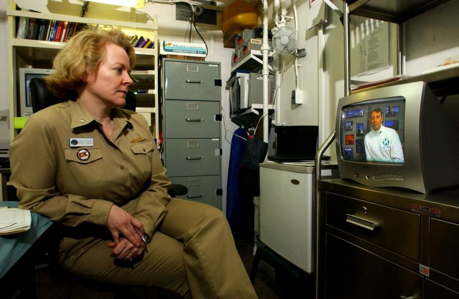 US Navy 030316-N-4308O-015 Cdr. Erin Patterson, Medical Officer aboard USS Harry S. Truman (CVN 75), watches a 'safety stand-down video' in her office