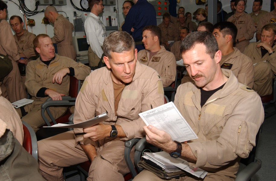 US Navy 030323-N-5932S-007 Two Naval Aviators assigned to Carrier Air Wing Fourteen (CVW-14) prepare for a brief in a squadron ready room aboard the aircraft carrier USS Abraham Lincoln (CVN 72)