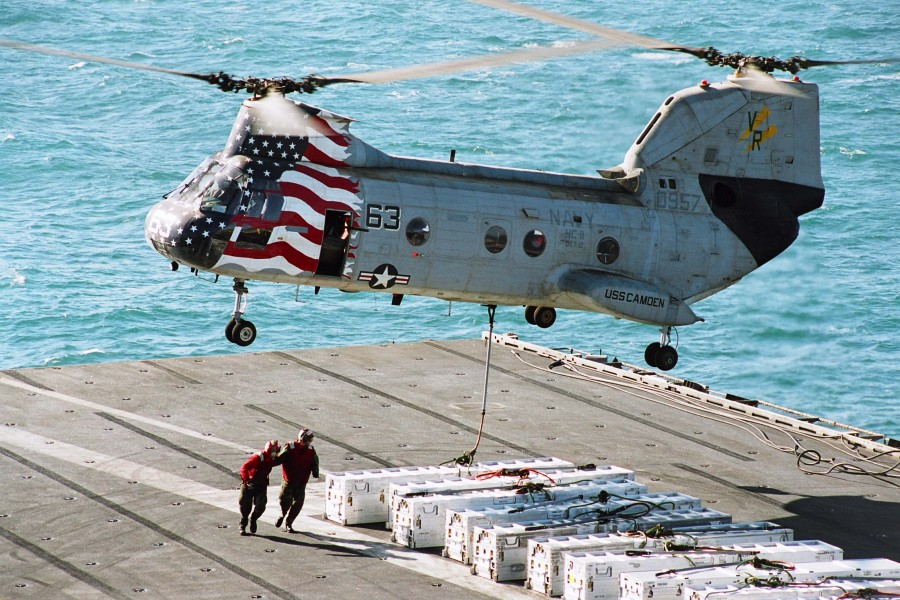 US Navy 030328-N-5292M-024 Sailors assigned to Weapon's department attach a pendant to a CH-46 Sea Knight assigned to Helicopter Combat Support Squadron Eleven Detachment Five (HC-11 Det. 5)