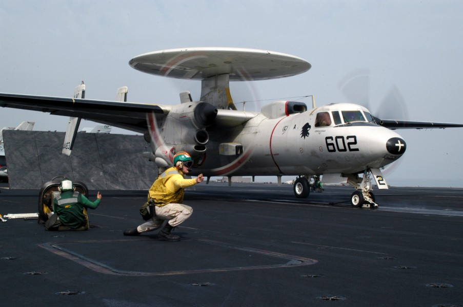US Navy 030401-N-6817C-008 The catapult officer checks all aspects of safety before launching an E-2C Hawkeye from aboard USS Abraham Lincoln (CVN 72)