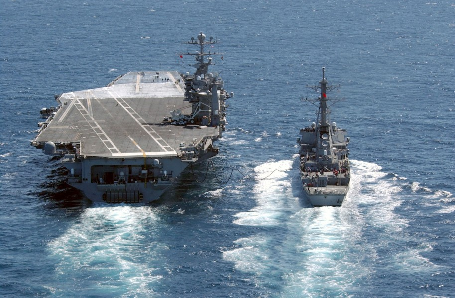 US Navy 030403-N-4768W-185 Guided missile destroyer USS John Paul Jones (DDG 53) pulls along side USS John C. Stennis (CVN 74) during an underway replenishment