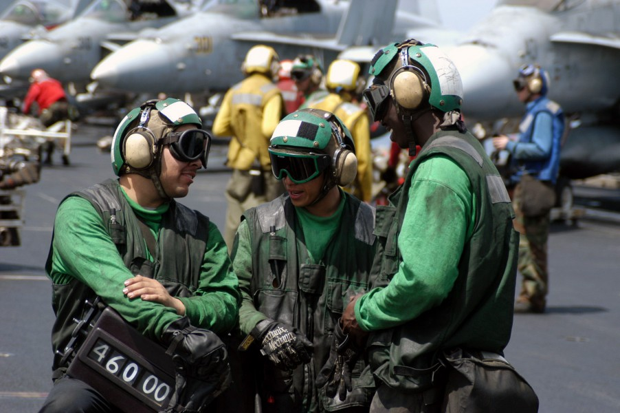 US Navy 030404-N-1159M-062 The Catapult crew from Air Department^rsquo,s V-2 Division discusses the next launch-cycle during a break in flight operations aboard USS Abraham Lincoln (CVN 72)