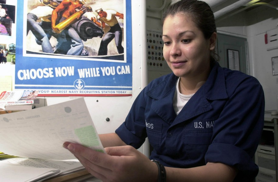 US Navy 030411-N-1577S-001 Personnelman Robin Cisneros of Corpus Christi, Texas reviews the enrollment sheet for English 1301 in the Education Services Office aboard USS Nimitz (CVN 68)