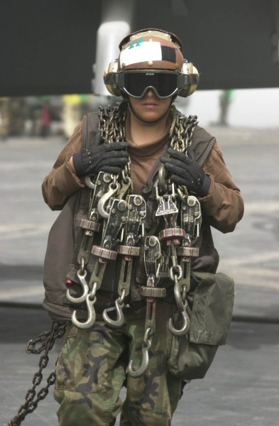 US Navy 030417-N-2385R-011 Airman Ana Tavira from Bloomington, Calif., crosses the flight deck after taking the tie down chains off of an aircraft on the flight deck aboard USS Nimitz (CVN 68)